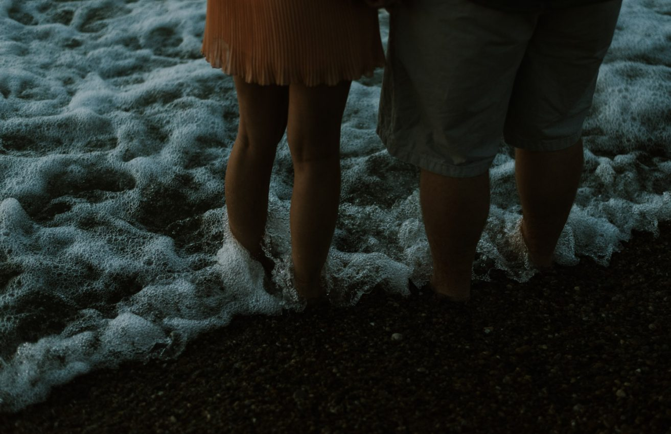 Couple standing in the water