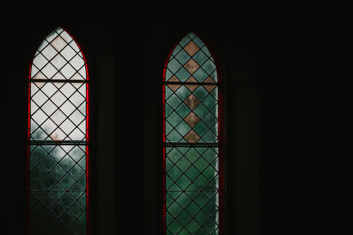 Windows at the church shine light into a darkened room