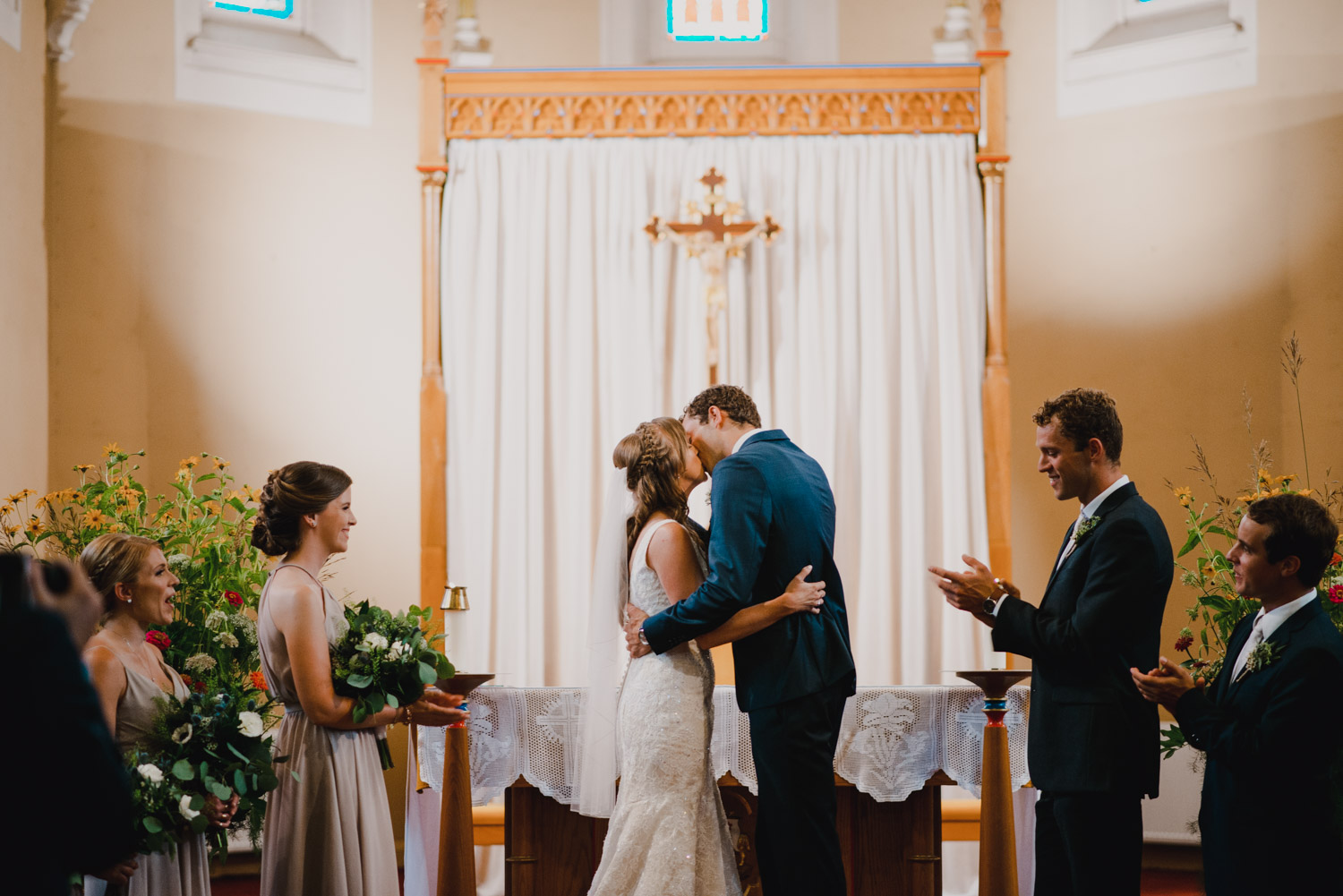 The bride and groom share their first kiss as a married couple