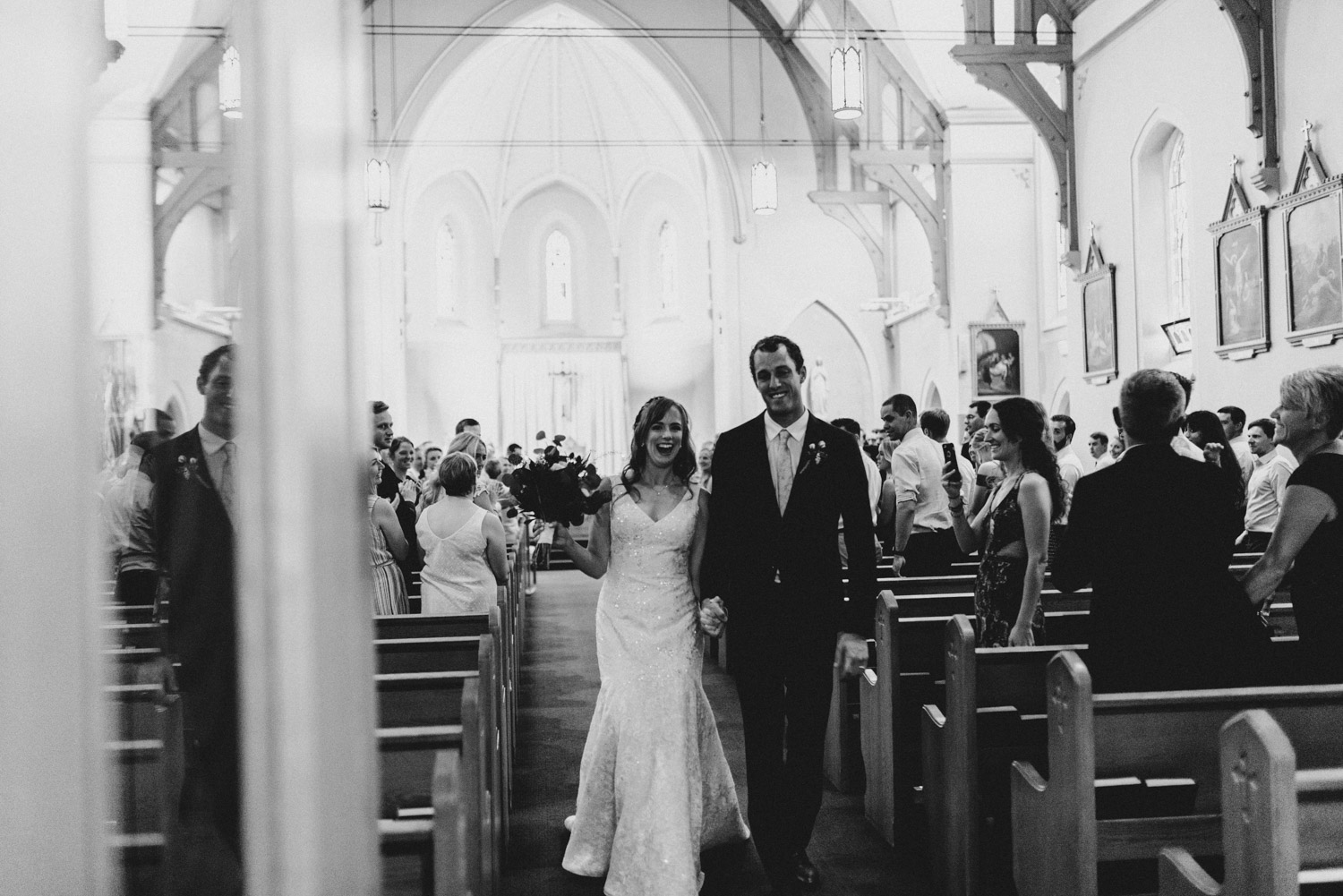 The bride and groom walk down the aisle together as a married couple
