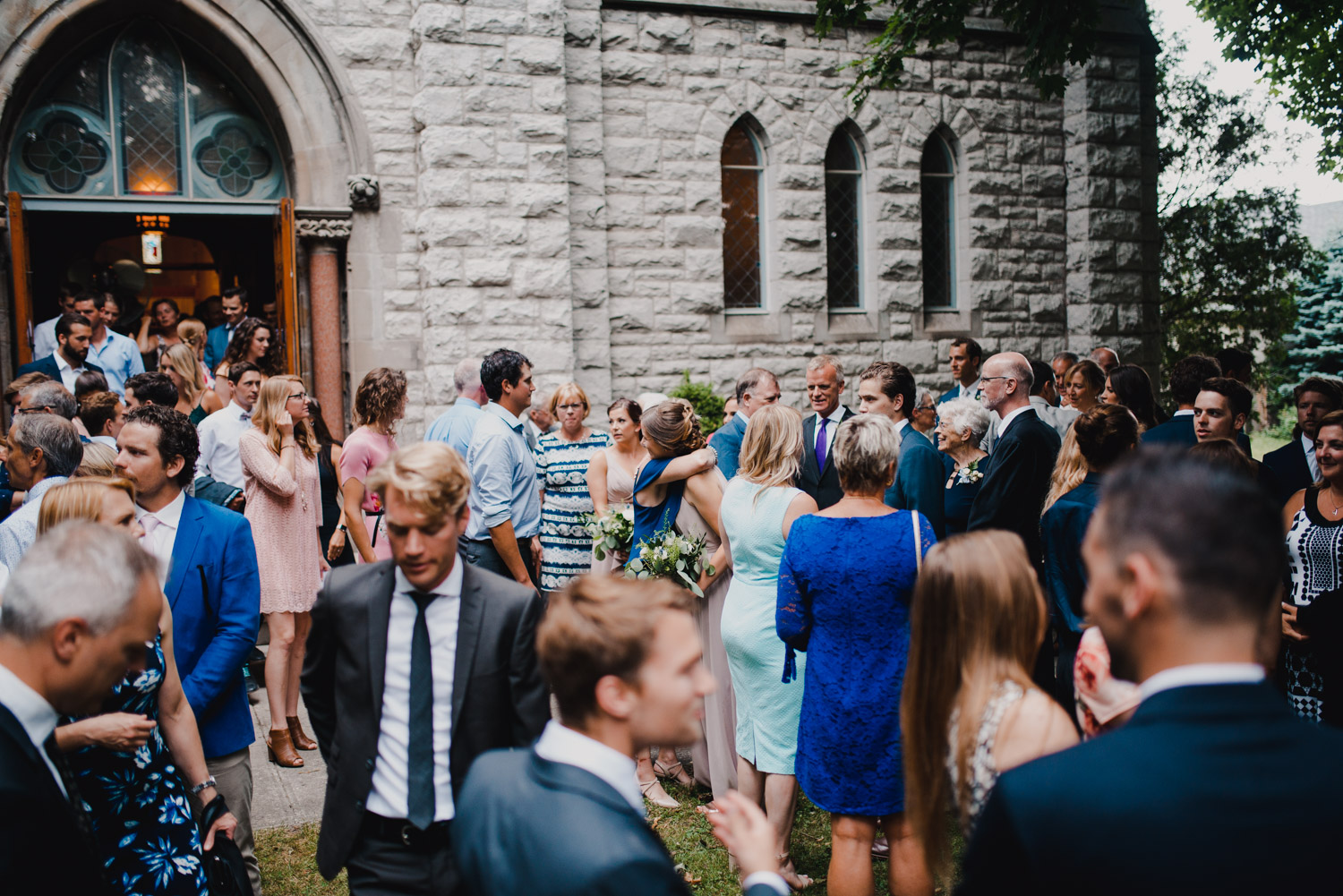 Guests gather outside of the church after the ceremony