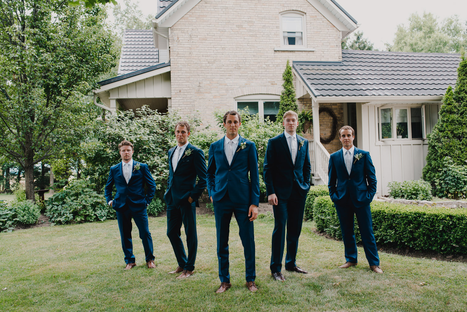 The groomsmen pose for a photo