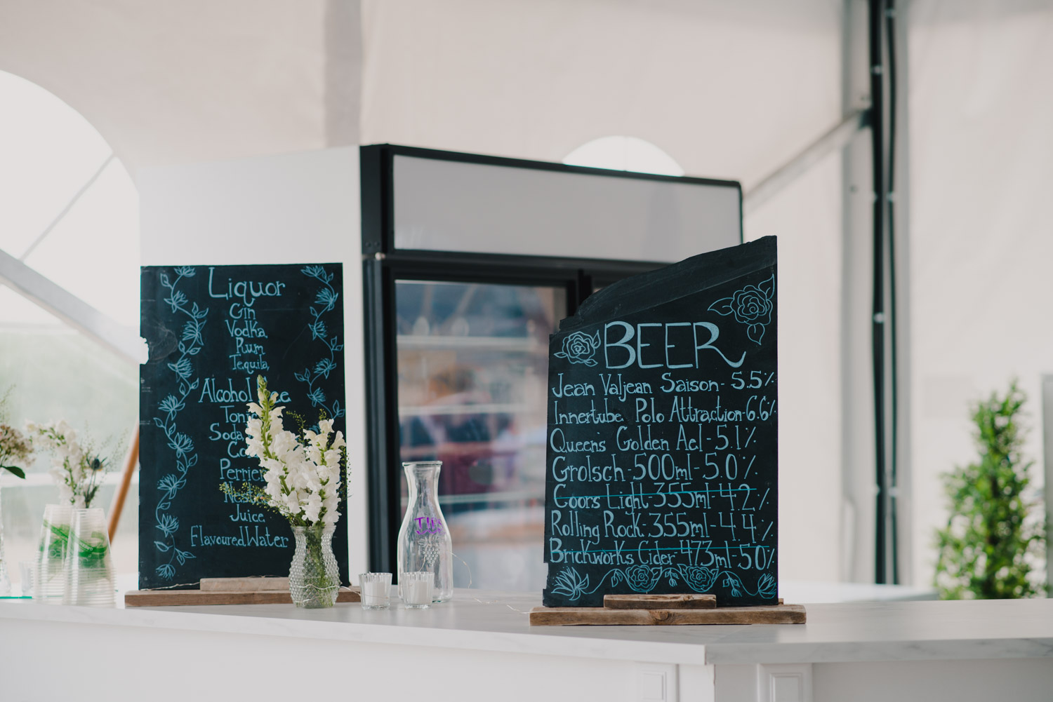 The beer menu, complete with craft beers with personalized titles for the couple