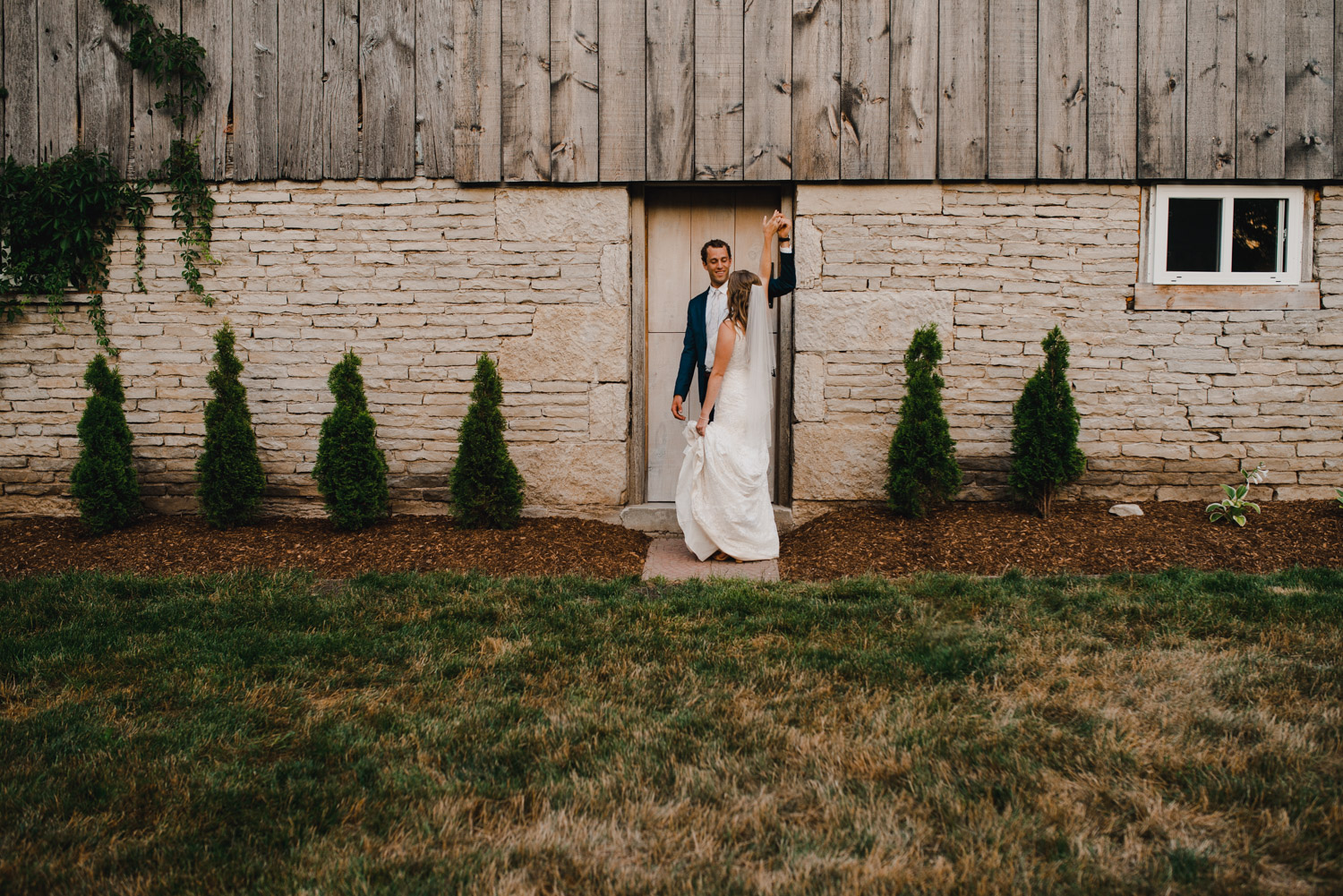 The bride and groom share a dance beside the barn at White Spruce Acres