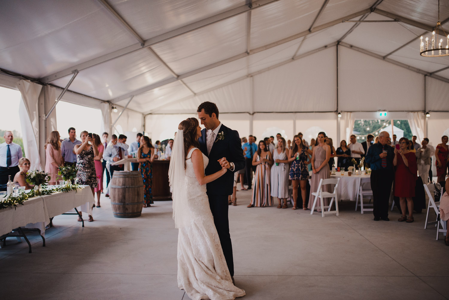 The bride and groom share their first dance as a married couple on the dancefloor