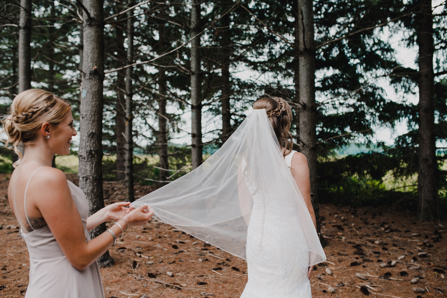A bridesmaid fixes the brides veil